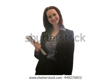 Good looking business woman portrait with notepad in office