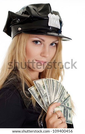 Good-looking girl in a uniform of  police officer on a white background - stock photo
