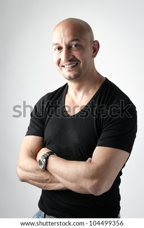 Good looking man with an open shirt and a woman's hands touching him from behind - stock photo
