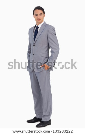 Good-looking man with hands in the pockets against white background - stock photo