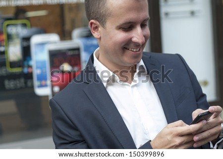 Good looking  Man With smartphone  siting on the floor