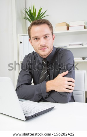 Good looking man working in office on laptop