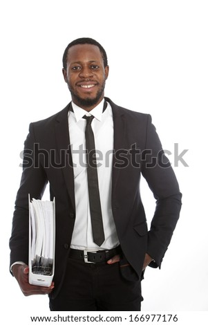 Good-looking middle-aged African businessman carrying a file under his arm standing smiling at the camera isolated on white
