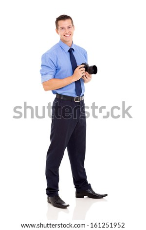 good looking photographer standing on white background - stock photo