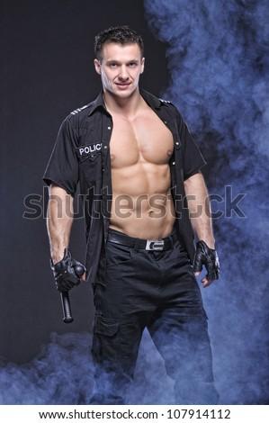 Good looking policeman - stock photo