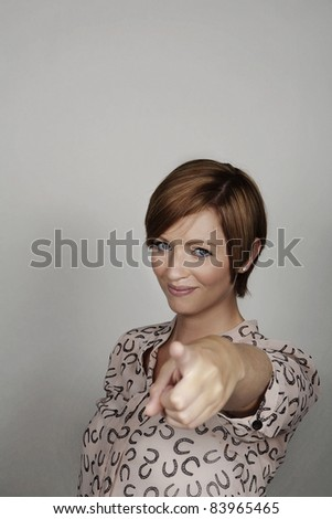 good looking woman pointing her finger at something - stock photo
