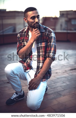 Good looking young arab man in casual clothes in urban environment