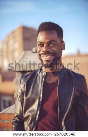 Good looking young black man in trendy clothes - stock photo