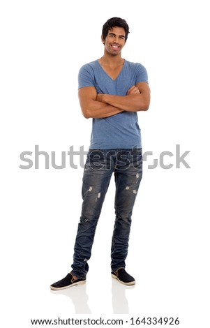 good looking young indian man standing on white background - stock photo