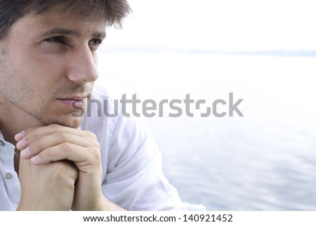 Good looking young man pensive - stock photo