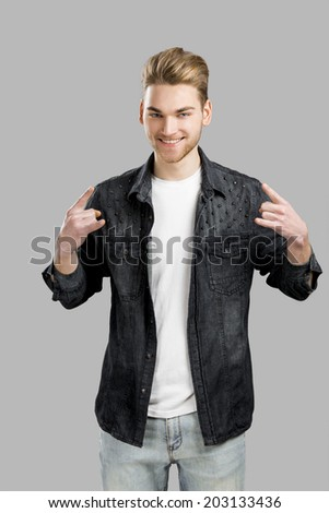 Good looking young man smiling, isolated over a gray background - stock photo