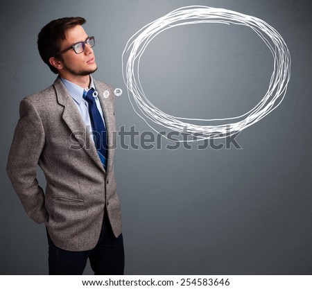 Good-looking young man thinking about speech or thought bubble with copy space - stock photo