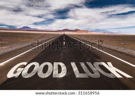 Good Luck written on desert road - stock photo