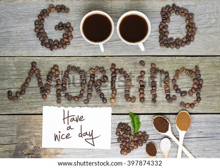 good morning and have a nice day concept - coffee beans, Cup of black coffee, heart from coffee beans, coffee leaves. Toned, selective focus image. lovely message - stock photo