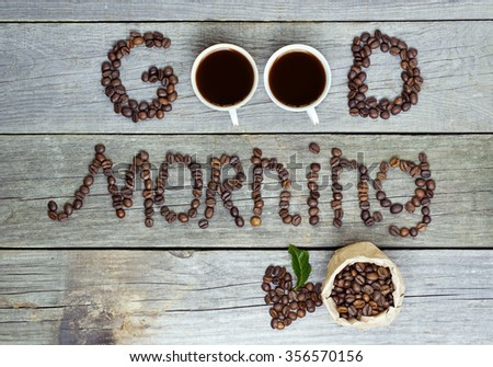 good morning concept - coffee beans, Cup of black coffee, heart from coffee beans, coffee leaves. Toned, selective focus image. lovely message - stock photo
