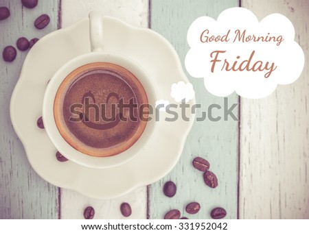 Good Morning Friday with coffee cup on table   - stock photo