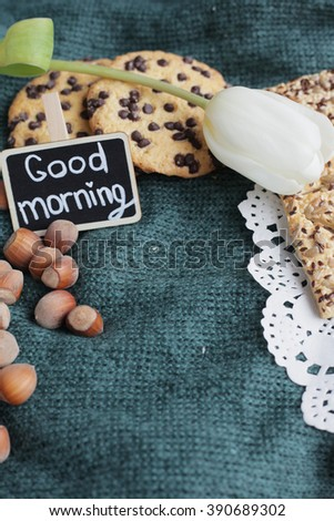 Good morning. Good morning blackboard. Rustic morning. Cookies on knitted background. White tulip.  - stock photo