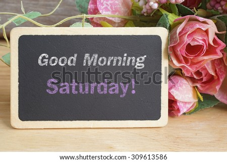 Good Morning Saturday word on chalkboard with roses bouquet - stock photo