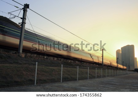 Good Morning :  under the bright, first train running / speed up on railway in hong kong, china, Tung Chung area, Lantau Island cityscape - stock photo