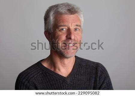 Good-natured and vibrant mature man senior adult - stock photo