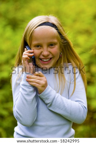Good news received by a young girl on a cell phone - stock photo