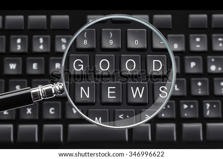 GOOD NEWS written on keyboard with magnifying glass