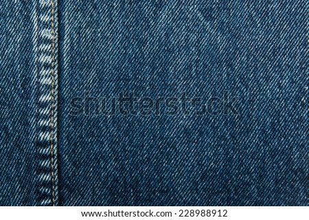 Good old American true denim jeans cloth background. Deep dark indian indigo blue color. Border with seam and stitches for fashion design, greeting cards and identity - stock photo