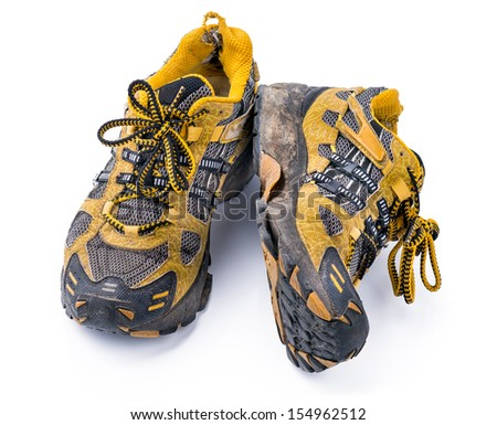 Good old Running Shoes Heavy used old dirty yellow running shoes, isolated on white background - stock photo