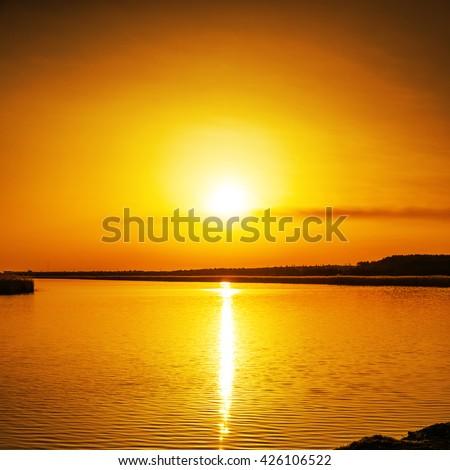 good orange sunset over river - stock photo