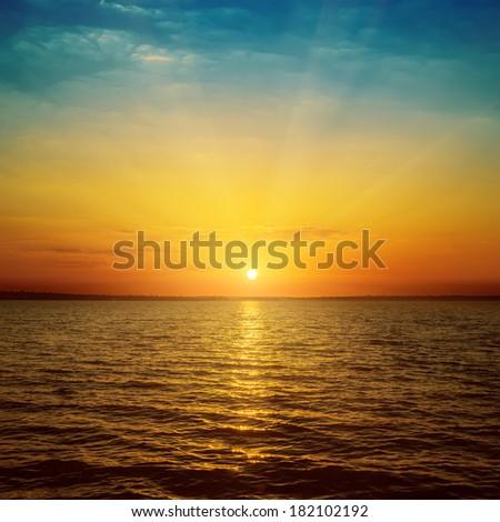 good orange sunset over sea - stock photo