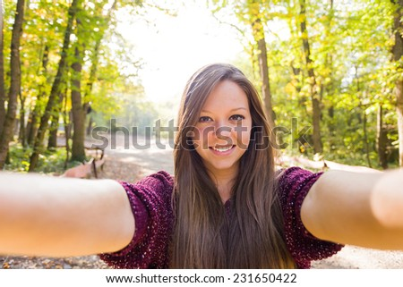 Good quality selfie with a brunette woman for social network - the camera 's point of view. - stock photo