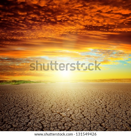 good red sunset over drought eart - stock photo