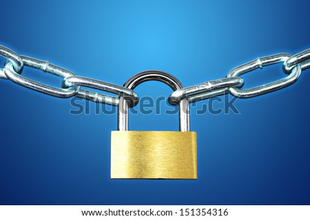 Good security. Close up of padlock and chain on blue background.  - stock photo