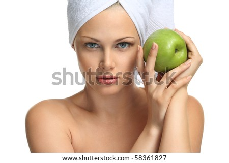 Good skin after bathing Beautiful blonde girl in towel and fresh apple - stock photo