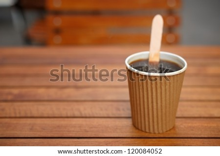 Good start to the day - a cup of coffee in the fresh air! - stock photo