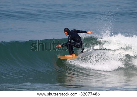 good surfer in action on a beautiful wave