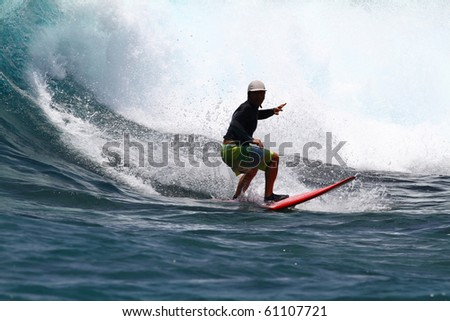 good surfer in action on a huge wave - stock photo