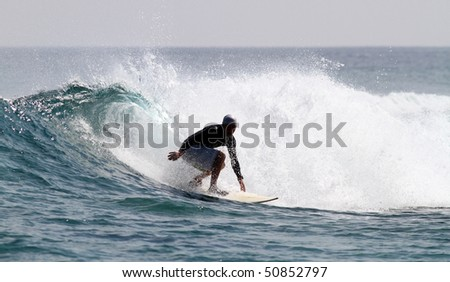 good surfer in action on a nice tropical wave - stock photo