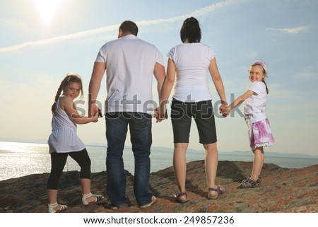 good time family in front of ocean