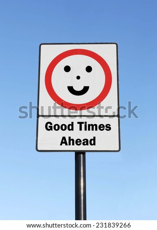 Good Times Ahead written on a road sign with a smiling face against a clear blue sky background - stock photo