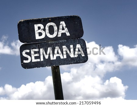 Good Week (In portuguese) sign with clouds and sky background  - stock photo