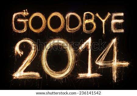 Goodbye 2014 word made from sparkler firework light - stock photo