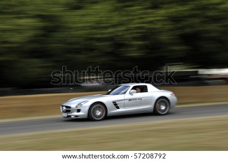 GOODWOOD, UNITED KINGDOM - JULY 3: AMG Mercedes SLS drives up the hill at the Goodwood Festival of Speed in the United Kingdom on July 3rd 2010 in Goodwood, UK - stock photo