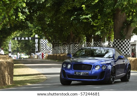 GOODWOOD, UNITED KINGDOM - JULY 3: Bentley Continental Supersports drives up the hill at the Goodwood Festival of Speed in the United Kingdom on July 3, 2010 in Goodwood, UK - stock photo