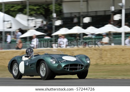 GOODWOOD, UNITED KINGDOM - JULY 3: Classic Aston Martin drives up the hill at the Goodwood Festival of Speed in the United Kingdom on July 3, 2010 in Goodwood, UK - stock photo
