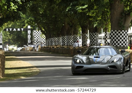 GOODWOOD, UNITED KINGDOM - JULY 3: koenigsegg Trevita drives up the hill at the Goodwood Festival of Speed in the United Kingdom on July 3, 2010 in Goodwood, UK - stock photo