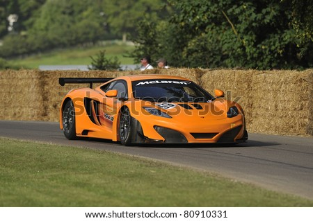 GOODWOOD, UNITED KINGDOM - JULY 1: The new McLaren MP4-12 GT3 Racing car  drives up the hill at the Goodwood Festival of Speed in the United Kingdom on July 1, 2011 in Goodwood, UK - stock photo