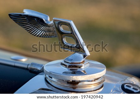 GOODWOOD, WEST SUSSEX/UK - SEPTEMBER 14 : Close-up modern Bentley badge at Goodwood on SEPTEMBER 14, 2012 - stock photo