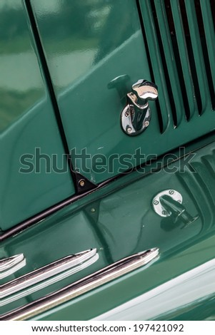 GOODWOOD, WEST SUSSEX/UK - SEPTEMBER 14 : Close-up of a bonnet release on an old Jaguar car at Goodwood on September 14, 2012 - stock photo
