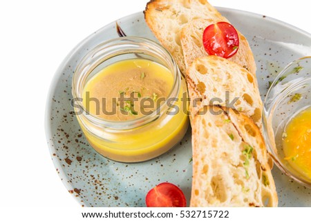 goose fresh pate with crackers and sauce on white plate
